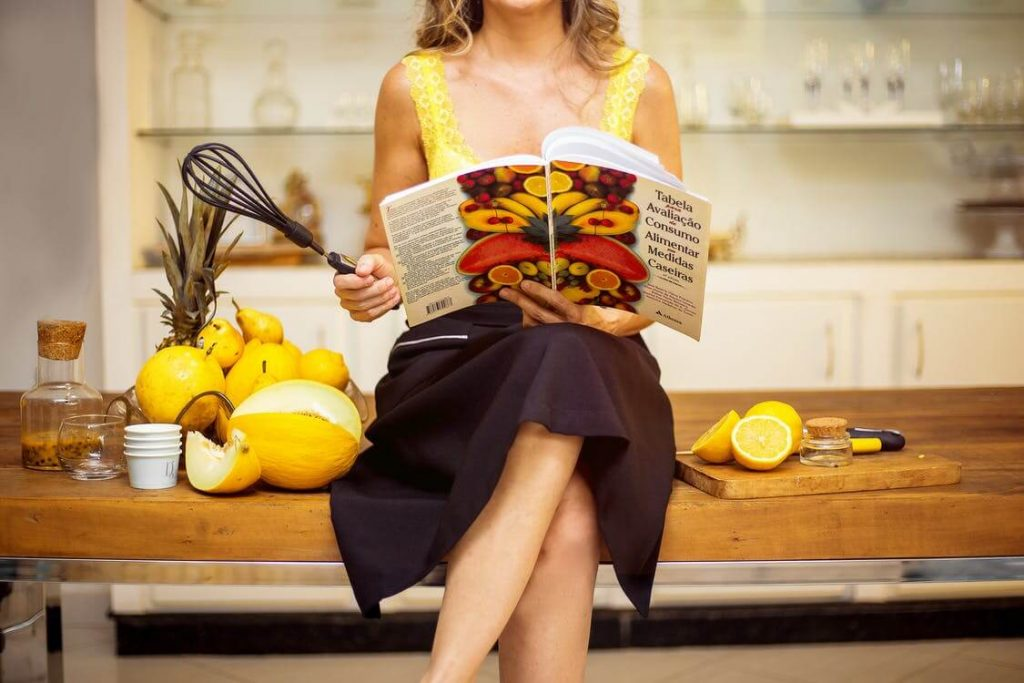 Women Sitting with a Cookbook
